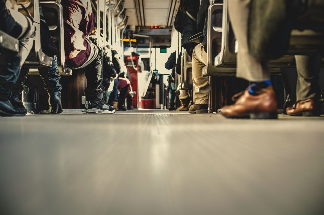 Source Pexels people-feet-train-travelling